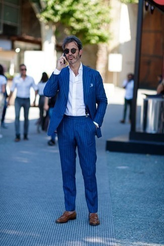 How to Wear Navy Suspenders: This ensemble with a blue vertical striped suit and navy suspenders isn't so hard to score and is easy to change according to circumstances. You could stick to the classic route when it comes to footwear by finishing with a pair of brown leather loafers.