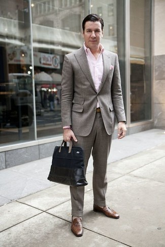 How to Wear a Pink Dress Shirt For Men: A pink dress shirt and a grey suit are worth being on your list of closet essentials. Brown leather loafers are a simple way to infuse a touch of stylish nonchalance into this ensemble.