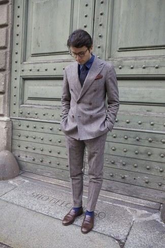 How to Wear a Navy Polka Dot Tie For Men: This pairing of a grey plaid suit and a navy polka dot tie can only be described as outrageously dapper and elegant. Add brown leather loafers to your look to loosen things up.