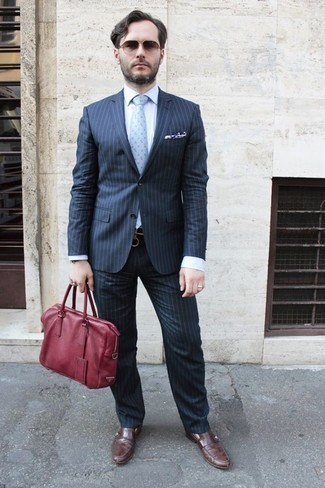 How to Wear Brown Sunglasses For Men: If you feel more confident wearing something practical, you'll appreciate this dapper combo of a navy vertical striped suit and brown sunglasses. If you need to instantly up the style ante of this ensemble with one single piece, complete your ensemble with brown leather loafers.