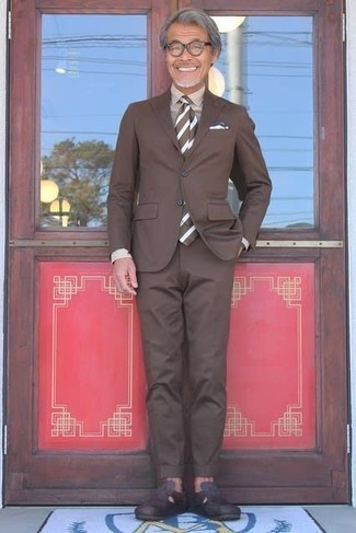 Beige Dress Shirt Outfits For Men: This ensemble demonstrates it is totally worth investing in such timeless menswear items as a beige dress shirt and a brown suit. Amp up this ensemble by finishing off with dark brown leather loafers.