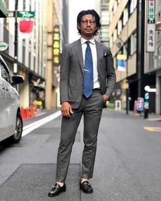 Navy and White Pocket Square Outfits: A grey suit and a navy and white pocket square are a combination that every dapper gent should have in his wardrobe. Take a classic approach with shoes and finish off with black leather loafers.