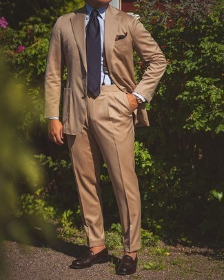 Suspenders Outfits: Consider teaming a tan suit with suspenders for an everyday outfit that's full of charm and personality. A nice pair of dark brown leather loafers is an effective way to give a hint of polish to your getup.