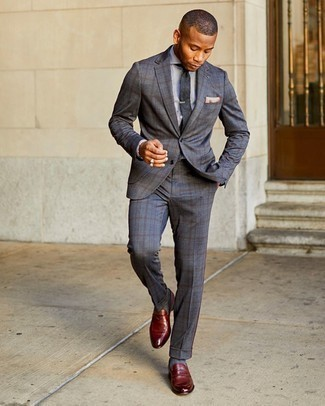 Dress Shirt Outfits For Men: Marrying a dress shirt and a charcoal plaid suit is a fail-safe way to infuse your current routine with some masculine sophistication. Burgundy leather loafers are a good choice to finish off this look.