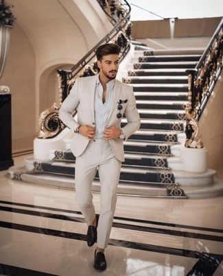Beige Suit Outfits: Make a fashionable statement anywhere you go by wearing a beige suit and a white dress shirt. Take a more relaxed approach with shoes and introduce black leather loafers to this outfit.