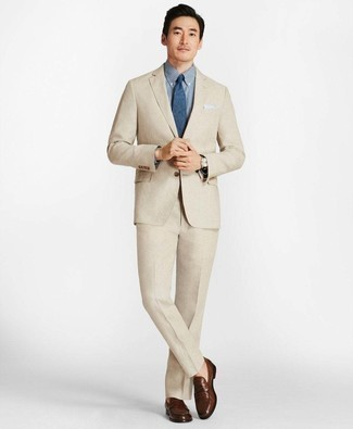 Beige Suit Outfits: A beige suit and a navy and white check dress shirt are absolute essentials if you're putting together a refined closet that matches up to the highest menswear standards. Brown leather loafers will be a stylish accompaniment to your outfit.