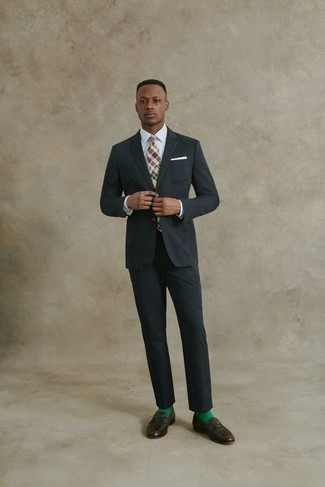 Dark Brown Leather Loafers Outfits For Men: This pairing of a black suit and a white dress shirt is a life saver when you need to look incredibly sharp and classy. Dark brown leather loafers will give a hint of stylish casualness to an otherwise mostly dressed-up look.