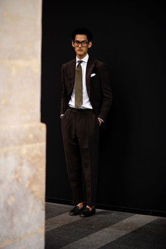 Dark Brown Suit Outfits: A dark brown suit and a white dress shirt are absolute wardrobe heroes if you're crafting a polished wardrobe that holds to the highest men's fashion standards. Add a pair of dark brown leather loafers to this outfit to make a mostly dressed-up ensemble feel suddenly fun and fresh.