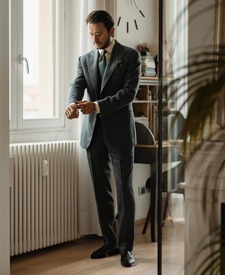 Gold Watch Outfits For Men: A charcoal suit and a gold watch will give off this casual and cool vibe. Black leather loafers are the most effective way to transform your getup.