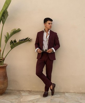 Men's Outfits 2021: A burgundy suit and a grey vertical striped dress shirt are among the basic elements of a good menswear collection. Burgundy woven leather loafers are a great option to finish off your ensemble.