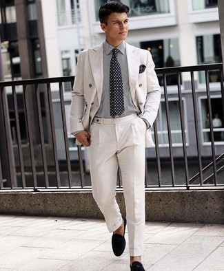 500+ Dressy Outfits For Men: A white suit and a white and black vertical striped dress shirt are a refined look that every sharp gent should have in his sartorial arsenal. A pair of black suede loafers is a savvy choice to finish your look.