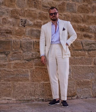Men's Outfits 2021: Combining a white suit and a light blue vertical striped dress shirt will prove your styling chops. Introduce navy suede loafers to this outfit and the whole outfit will come together.