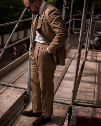 Brown Suit Outfits: We're loving how this combo of a brown suit and a white dress shirt immediately makes men look smart and sophisticated. If you wish to easily tone down this outfit with a pair of shoes, why not throw dark brown suede loafers into the mix?
