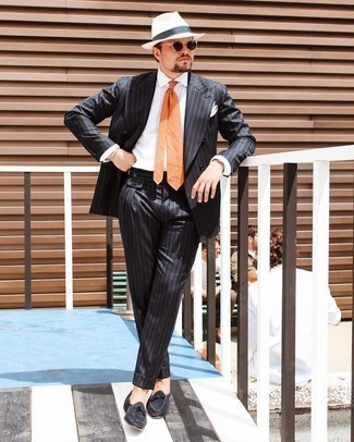 Orange Tie Outfits For Men: Pairing a black vertical striped suit with an orange tie is an amazing idea for a stylish and elegant outfit. Black suede loafers will give a hint of stylish effortlessness to an otherwise classic look.