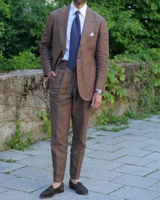 Brown Suit Outfits: You're looking at the undeniable proof that a brown suit and a white dress shirt are awesome when paired together in a classy look for a modern gentleman. Give a fresh twist to an otherwise mostly dressed-up ensemble with dark brown suede loafers.