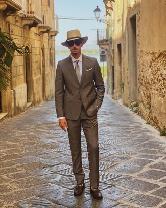 Brown Suit Outfits: Make women go weak in the knees in a brown suit and a white dress shirt. A pair of dark brown leather loafers easily amps up the wow factor of your ensemble.
