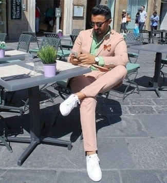 How to wear: pink suit, mint dress shirt, white leather low top sneakers, dark brown sunglasses