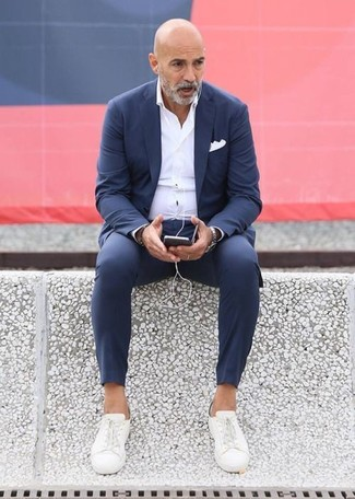 How to wear: navy suit, white dress shirt, white canvas low top sneakers, white pocket square