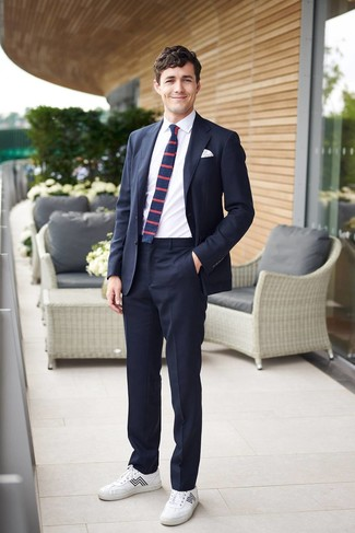 How to wear: navy suit, white dress shirt, white leather low top sneakers, navy horizontal striped tie