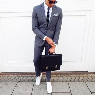 How to wear: charcoal suit, white dress shirt, white low top sneakers, black leather briefcase