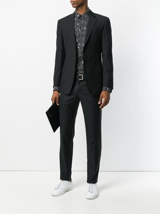 How to wear: black suit, black and white polka dot dress shirt, white leather low top sneakers, black leather zip pouch