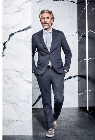 How to Wear Grey Suede Low Top Sneakers For Men: A charcoal suit looks so polished when combined with a white dress shirt for an ensemble worthy of a British gent. You know how to tone down this outfit: grey suede low top sneakers.