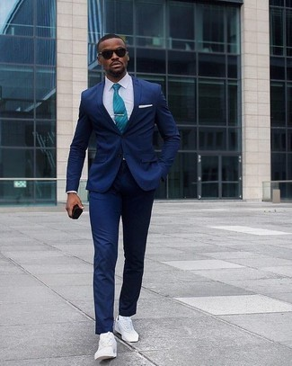 Men's Looks & Outfits: What To Wear In a Dressy Way: This combo of a navy suit and a white dress shirt is a real life saver when you need to look really classy. White canvas low top sneakers are the most effective way to add an element of stylish nonchalance to this ensemble.