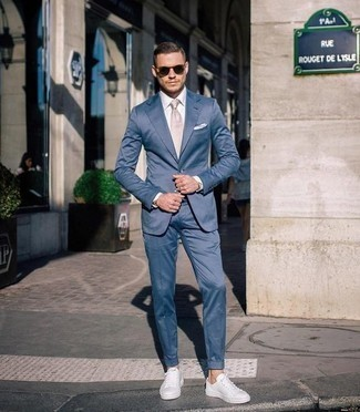 Men's Looks & Outfits: What To Wear In a Dressy Way: A blue suit and a white dress shirt are a seriously dapper look to try. Complement this outfit with white canvas low top sneakers to make the ensemble more functional.