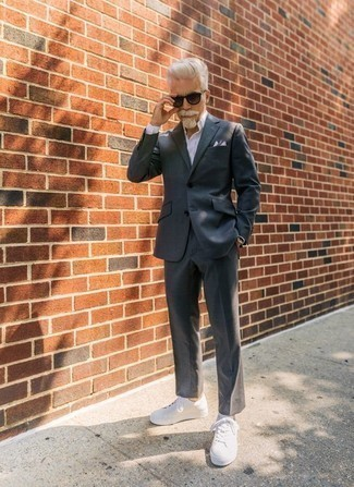 How to Wear a Pocket Square After 50: Parade your prowess in men's fashion by pairing a charcoal suit and a pocket square for a casual outfit. White canvas low top sneakers are the perfect accompaniment to this outfit.