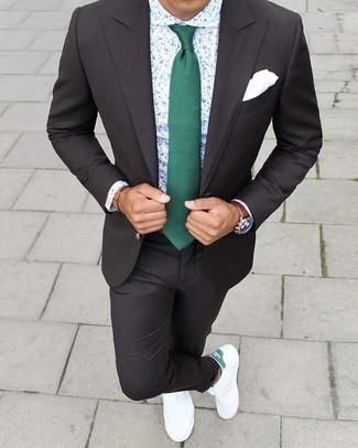 How to Wear a Charcoal Suit: We're loving how this combination of a charcoal suit and a white and navy dress shirt instantly makes men look refined and dapper. Feeling venturesome? Break up this ensemble by wearing white and green canvas low top sneakers.