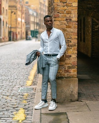 Dress Shirt Outfits For Men: A dress shirt looks especially polished when married with a light blue plaid suit. When this outfit appears too fancy, play it down by slipping into a pair of white and black canvas low top sneakers.