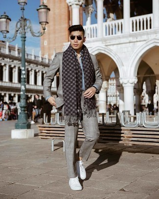 Scarf Outfits For Men: Why not wear a grey plaid suit and a scarf? These pieces are totally practical and look awesome together. A pair of white canvas low top sneakers is a nice pick to complement your ensemble.