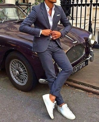 Navy Suit Outfits: This polished combination of a navy suit and a white dress shirt will cement your outfit coordination skills. Infuse a more casual spin into your ensemble by sporting a pair of white canvas low top sneakers.
