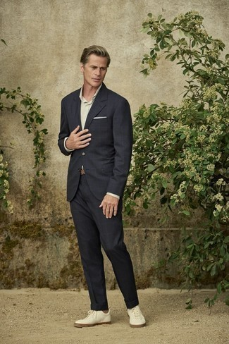 White Pocket Square Outfits: For a relaxed ensemble, pair a black check suit with a white pocket square — these pieces work perfectly well together. The whole outfit comes together quite nicely if you introduce a pair of white leather low top sneakers to the equation.