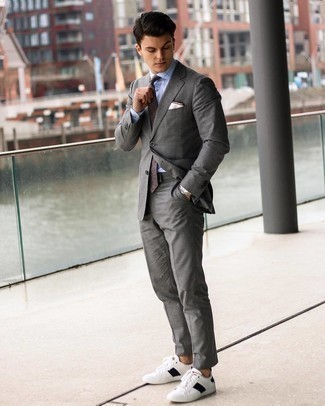 Men's Outfits 2021: We're loving the way this combination of a grey suit and a light blue check dress shirt instantly makes a man look elegant and smart.