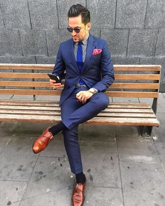 How to wear: navy suit, white and black vertical striped dress shirt, tobacco leather monks, blue knit tie