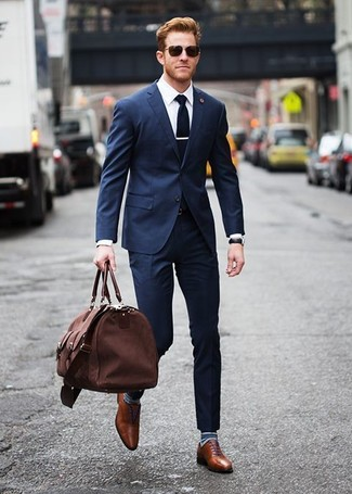 A navy suit and a white dress shirt will showcase your sartorial self. Polish off the ensemble with oxford shoes.