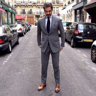 How to wear: charcoal suit, white dress shirt, brown leather oxford shoes, black tie