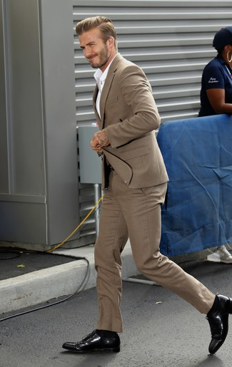 How to wear: tan suit, white dress shirt, black leather oxford shoes, black leather belt