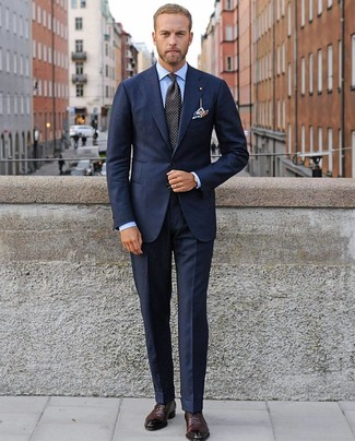 How to wear: navy suit, light blue dress shirt, burgundy leather oxford shoes, black polka dot tie
