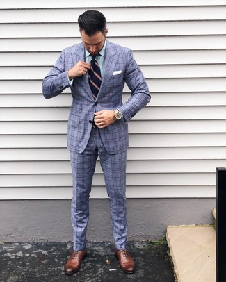 How to wear: light blue plaid suit, green vertical striped dress shirt, brown leather oxford shoes, navy vertical striped tie