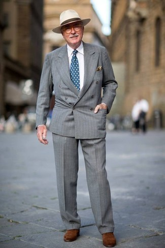 Fashion for Men Over 60: What To Wear: This classy combo of a grey vertical striped suit and a white dress shirt will cement your sartorial prowess. A pair of brown suede oxford shoes is a smart idea to round off this ensemble. If you're often worried about dressing age-appropriately, this pairing is a real life saver.