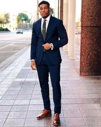 How to Wear a Navy and White Horizontal Striped Tie For Men: Marrying a navy suit with a navy and white horizontal striped tie is a savvy idea for a smart and polished look. Tobacco leather oxford shoes will bring a more laid-back spin to an otherwise all-too-safe getup.