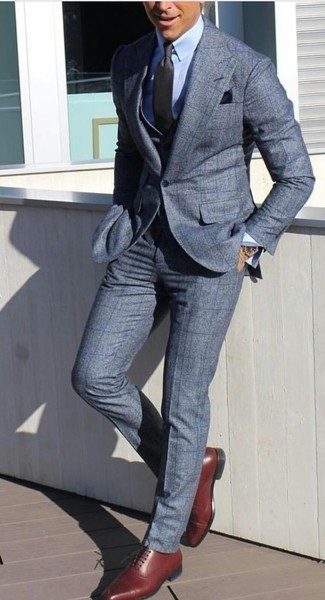 How to Wear a Black Pocket Square: Go for a pared down but cool and relaxed choice in a blue check suit and a black pocket square. Kick up the wow factor of this ensemble by slipping into a pair of burgundy leather oxford shoes.