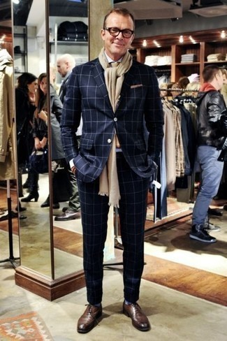 How to Wear Socks For Men: Want to infuse your closet with some laid-back dapperness? Choose a navy check suit and socks. A pair of brown leather oxford shoes can immediately elevate any outfit.