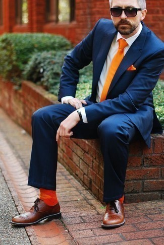 How to Wear Orange Socks For Men: Team a navy suit with orange socks for comfort dressing with a twist. Tap into some David Gandy dapperness and class up your ensemble with a pair of brown leather oxford shoes.