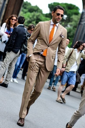How to Wear a Tan Suit: Make a tan suit and a white dress shirt your outfit choice for a sleek classy look. Complement this look with a pair of dark brown leather oxford shoes and the whole look will come together brilliantly.