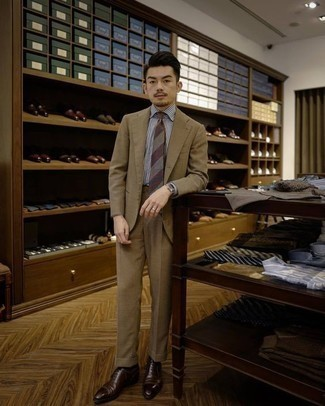 How to Wear a Tan Suit: Look your best in a tan suit and a white and navy vertical striped dress shirt. Dark brown leather oxford shoes will pull your full look together.