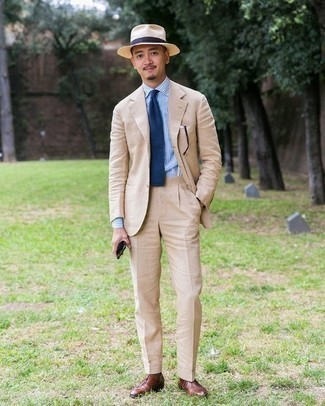 How to Wear a Navy Tie For Men: Dress for success in a beige suit and a navy tie. When it comes to shoes, go for something on the relaxed end of the spectrum by rocking a pair of brown leather oxford shoes.