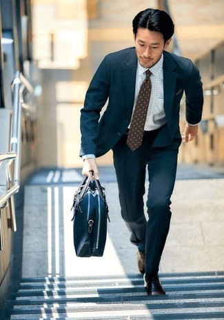 How to Wear a Navy Canvas Briefcase: Such must-haves as a navy suit and a navy canvas briefcase are the ideal way to introduce effortless cool into your daily off-duty rotation. Complement your outfit with brown leather oxford shoes to immediately dial up the classy factor of this ensemble.